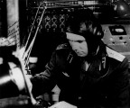 Ю.А. Гагарин в ЛИИ, у тренажера «пульта пилота-космонавта» готовится к экзамену